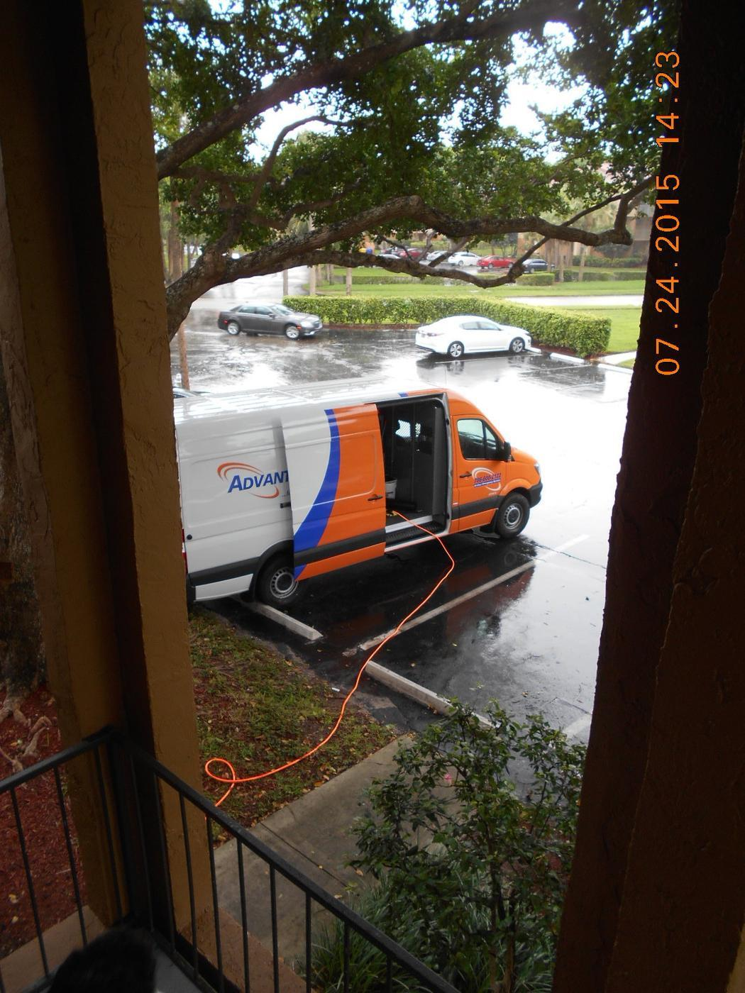 AdvantaClean truck at a dryer vent cleaning